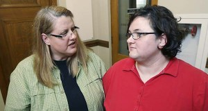 In this photo taken June 8, 2015, same-sex couple Dianna Christy, left, and Markett Humphries leave a courtroom at the Pulaski County Courthouse in Little Rock, Ark.  A judge ordered Arkansas officials on Tuesday to recognize more than 500 same-sex marriages performed in the state last year. (AP Photo/Danny Johnston)