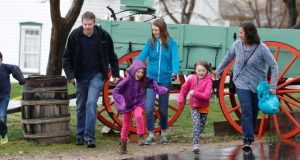 In this April 6, 2018, photo, Amy Coulter, right, and her husband Mark, second left, play with their children at the Place Heritage Park in Salt Lake City. After Utah passed the country's first law legalizing so-called free-range parenting, groups from New York to Texas are pushing for similar steps to bolster the idea that supporters say is an antidote for anxiety-plagued parents and overscheduled children. (Rick Bowmer/AP photo)