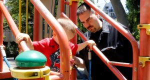 Glen Wood, a Canadian who has lived in Japan for 30 years, plays with his son at a Tokyo park in early June. Wood is fighting a courtroom battle in Japan over what he alleges is paternity harassment. He says major brokerage Mitsubishi UFJ Morgan Stanley demoted him and then dismissed him after he took time off to be with his prematurely born newborn son. Although Japan guarantees up to 12 months of paid parental leave, only 3 percent of men exercise that right. (AP Photo/Yuri Kageyama)