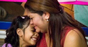 In this July 13, 2018, file photo, Allison, 6, and her mother Cindy Madrid share a moment during a news conference in Houston, where the mother and daughter spoke about the month and one day they were separated under the President Donald Trump administration immigration policy. The Trump administration is due back in court Monday, July 16, 2018, to discuss a plan reunify more than 2,500 children who were separated at the border from their parents. (Marie D. De Jes's/Houston Chronicle via AP, File)