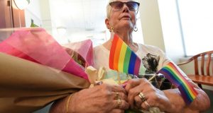 """In this Tuesday, Aug. 21, 2018 photo, Bonnie Foerster, 74, of South Salt Lake, Utah, finally gets her wish of marrying her common law partner of 50 years, Beverly Grossaint, even though she died at age 82 in May 2018. Foerster, who is legally blind and a double amputee shed tears of joy exclaiming """"I can finally start healing,"""" after a judge provided the legal recognition and allowed her to be legally married. (Francisco Kjolseth/The Salt Lake Tribune via AP)"""