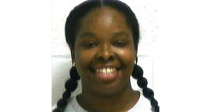 FILE - In this file photo provided by the Oklahoma Department of Corrections, Tondalao R. Hall is pictured in a photo dated July 7, 2009. A criminal justice group that's working to reduce Oklahoma's prison population says Hall's 30-year prison sentence for failing to report the abuse of her children by a boyfriend who served only two years for the abuse illustrates a wider problem. (Oklahoma Department of Corrections via AP, File)