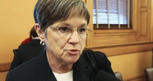 Kansas Gov.-elect Laura Kelly wants to roll back a work requirement and other rules for cash assistance recipients backed by conservative Republicans. (AP Photo/John Hanna)