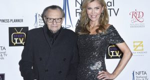 FILE - In this Dec. 5, 2018 file photo Larry King, left, and Shawn King attend the 2018 National Film & Television Awards at the Globe Theatre in Los Angeles. King has filed for divorce from his seventh wife, Shawn King, after 22 years. The 85-year-old talk show host filed a petition to end the marriage Tuesday, Aug. 20, 2019 in Los Angeles Superior Court. (Photo by Richard Shotwell/Invision/AP)