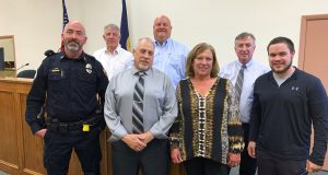 This Nov. 19, 2019, photo shows members of the new Truancy Court in Butte, Mont.ana  From left are school resource officer Tim McMahon, Justice of the Peace Jimm Kilmer, Justice of the Peace Ben Pezdark, City Court Judge Jerome McCarthy, Chief Juvenile Probation Officer Jennifer Briggs, West Elementary Principal Pat Kissell and Deputy Juvenile Probation Officer Jackson Kappes. Butte has created the Truancy Court to help identify the reasons some children chronically miss school. (Mike Smith/The Montana Standard via AP)