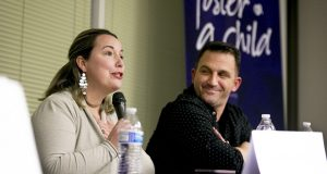 This photo taken Feb. 25, 2020, shows Shanda Simoncini, of South Jordan, speaking about her family's experience with foster care while her husband, Tony, laughs with her during a question-and-answer forum with current foster parents hosted by Utah Foster Care at the organization's state headquarters in Murray, Utah. (Isaac Hale/The Daily Herald via AP)