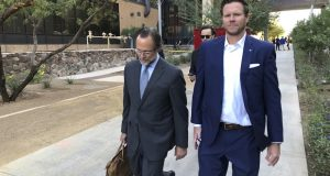 Then-Maricopa County Assessor Paul Petersen, right, and his attorney, Kurt Altman, leave a Nov. 5, 2019, court hearing in Phoenix. The former Arizona politician could serve up to 15 years in prison for operating an illegal adoption scheme involving women from the Marshall Islands after he was given his third sentence Wednesday, April 21, 2021, in Utah. Petersen had already been ordered to serve 11 years in prison in Arizona and Arkansas.(AP Photo/Jacques Billeaud, File)
