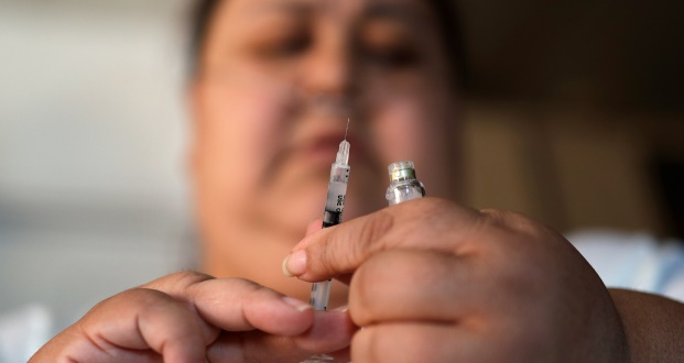 In this April 18, 2017, photo, Soila Solano prepares to inject herself with insulin at her home in Las Vegas. Solano was diagnosed with Type 2 diabetes six years ago. Casino owners and their employees' unions are attempting to rein in soaring prescription drug prices in an attempt to control their own medical insurance costs. They and Democratic lawmakers backing the bill also hope it would cap what diabetics pay out of their own pockets for insulin. (AP Photo/John Locher)