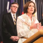 In this March 6, 2017, file photo, Texas Sen. Lois Kolkhorst, front, backed by Texas Lt. Gov. Dan Patrick, center, and other legislators talks to the media during a news conference to discuss Senate Bill 6 at the Texas Capitol in Austin, Texas. Just months after a high-profile study revealed that Texas has one of the highest maternal mortality rates in the developed world, state lawmakers failed to respond by passing comprehensive legislation to combat the crisis during the legislative session. (Eric Gay/AP file photo)