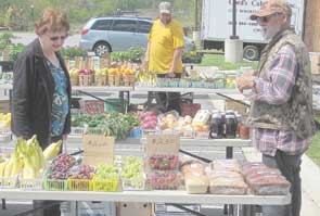 Charles Bowling (right) has been a vendor at the farmers' market in La Plata for all of the 33 years that it has been in existence. Farmers' markets have been expanding rapidly across the state over the last two years.