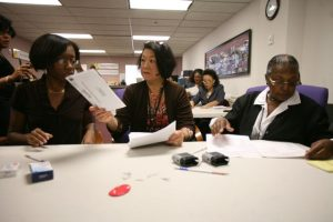 Tara Andrews, Eleanor Wang and Barbara Logan review absentee ballots at the Baltimore City Election Boards office Thursday Sept. 16, 2010. (The Daily Record/Rich Dennison)