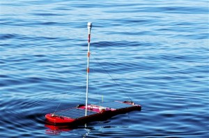 This undated handout photo provided by BP, shows a Wave Glider, a new type of robotic boat measuring water quality and  doing scientific research for BP.  It is satellite controlled, gets its propulsion power from wave action, and uses solar power to run its scientific electronics.