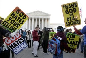 Members of the Westboro Baptist Church picket in front of the Supreme Court in Washington, Wednesday, Oct. 6, 2010. The court is hearing arguments Wednesday in the dispute between Albert Snyder of York, Pa., and members of the Westboro Baptist Church of Topeka, Kan. The case pits Snyder's right to grieve privately against the church members' right to say what they want, no matter how offensive.