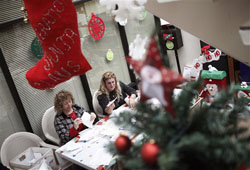 U.S. Postal Service employees Sandy Platz, left, and Janet Meyers sort letters written to Santa Claus as part of Operation Santa
