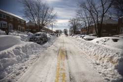 Residents begin to dig out their cars along Kings Ridge Rd. in Parkville, Md. Sunday Feb. 7, 2010.