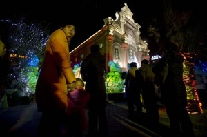 Visitors attend mass held on Christmas eve at the Southern Cathedral, the oldest Catholic church in Beijing, China.