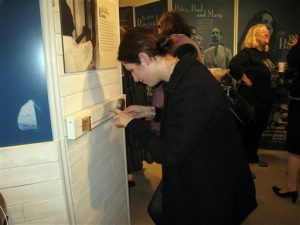 "A visitor tries out a diddley bow in the ""Blues"" section of the traveling exhibition"
