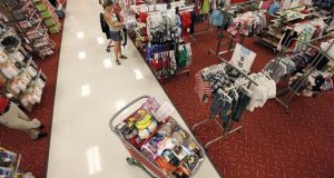A shopper fills her cart at a Target store Thursday, July 5, 2012, in Chicago.  (AP Photo/M. Spencer Green)