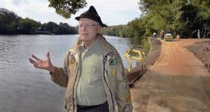 In this 2012 photo, Tom Perry talks about the repairs being done on the C&O Canal path near Big Slackwater in Williamsport. (AP Photo/The Herald-Mail, Ric Dugan)