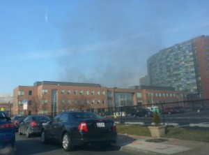 Black smoke is visible on Orleans Street from the Johns Hopkins Hospital campus Wednesday morning. (Erin Alexander/The Daily Record)