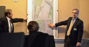 Warner Mueller and Charles Belser of Los Angeles-based firm AECOM explain the design of the proposed Red Line maintenance facility to the Urban Design and Architectural Review Panel Thursday. (Josh Cooper/The Daily Record)