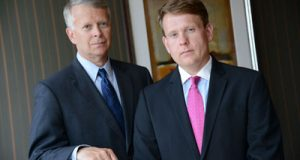 Andrew C. White (left) and Steven J. Kelly represent the unnamed plaintiff in the $32 million suit against hundreds of people who allegedly received pornographic images of her children being sexually abused.