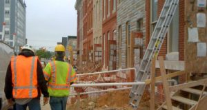 Construction workers are gutting and rehabbing 18 row houses in the 700 block of East Preston Street, bringing the total to 30 in a two-block area of East Baltimore.