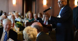 Charter member George L. Russell Jr. addresses The Center Club at Thursday's celebration.