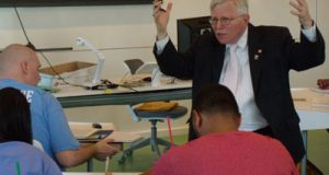 Byron Warnken teaches the first class at the John and Frances Angelos Law Center at University of Baltimore School of Law. Warnken also taught the first class at the old law building more than three decades ago.