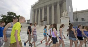 High school students from Austin, Minn., visit the Supreme Court on Monday in anticipation of key decisions being announced.
