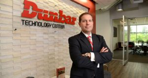 Christopher M. Ensey, COO of Dunbar Armored Inc., presents the new Dunbar Technology Center in Hunt Valley.