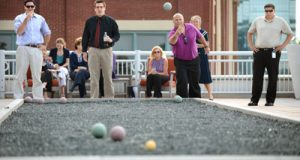 From left: Summer associates Nick Mongelluzzo and Nick Rupkey face Facilities Assistant John West and Administrative Services Assistant Michael Garey in the championship game of Venable's sixth annual bocce league. 'We take it one ball at a time and we got lucky on a few throws, but it's been a lot of fun,' Mongelluzzo says.
