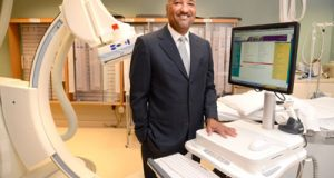 Andre Lynch, CEO of Ingenium Corporation, shown here at Laurel Regional Hospital in a Cath Lab with a wireless WOW (Workstation On Wheels) unit, that his company supports for Demensions Healthcare Syestem's electronic health records platform.
