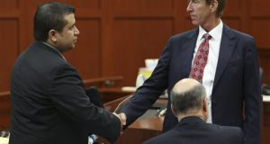 George Zimmerman, left, shakes hands with his defense attorney Mark O'Mara during a recess in his trial in Seminole circuit court in Sanford, Fla. Wednesday, July 10.