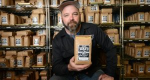 Photo of Thomas Rhodes, owner of Zeke's Coffee