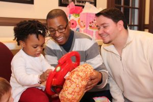Chris Maulden-Locke (center) and Doug Maulden-Locke (right), a same-sex couple, adopted their daughter Mya (left) in Montgomery County in February. Photo courtesy of the Maulden-Lockes.