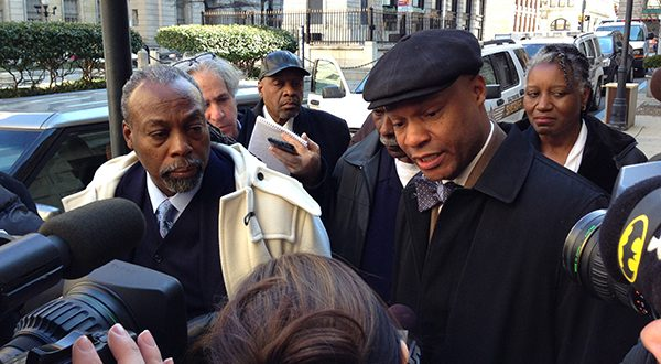 Julius Henson, on left, and his lawyer, Russell A. Neverdon Sr., right (in hat), outside of Baltimore City Circuit Court on Feb. 27 after judge found Henson violated his probation by running for office. (The Daily Record/Danny Jacobs)