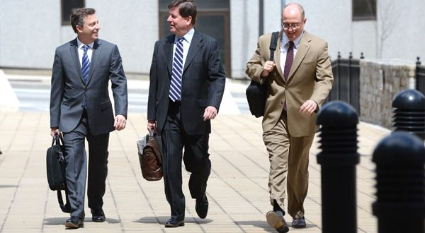 Lawrence Yumkas, left, and Robert T. Schmidt, representing First Mariner Bancorp, walk into bankruptcy court Monday morning. (The Daily Record/Maximilian Franz)