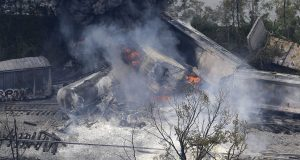A fire burns at the site of the May 2013 CSX freight train derailment in Rosedale, where fire officials say the train crashed into a trash truck, causing an explosion that rattled homes at least a half-mile away and collapsed nearby buildings, setting them on fire. (AP Photo)
