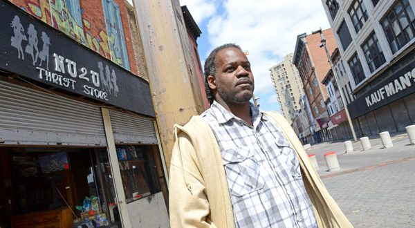 Charles Winston, standing in front of the Nu 2 U Thrift Store he and his wife operate at the Old Town Mall, says: 'If they could do something positive for the area, it would be for the better.' (The Daily Record/Maximilian Franz)