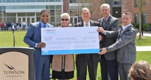 Towson University President Maravene Loeschke (second from left) and other school officials accept a check for $1.7 million from Calvin G. Butler, the CEO of BGE (left), to finance energy-efficient upgrades on-campus. (Photo courtesy of Towson University)