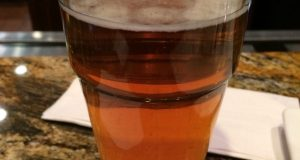 A photo of a beer being served in a Baltimore restaurant. (The Daily Record/Adam Bednar)