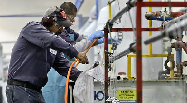 Employees at Sheffield Platers Inc. work on the factory floor in San Diego. (AP Photo/Lenny Ignelzi, File)