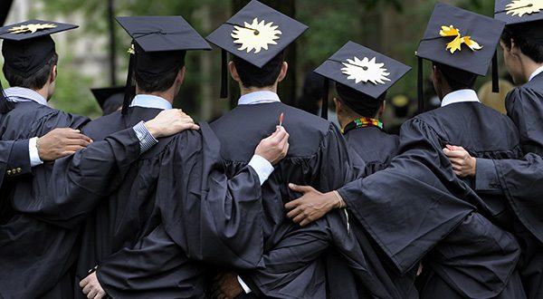 Graduates pose for photographs during commencement at Yale University in New Haven, Conn. (AP Photo/Jessica Hill, File)