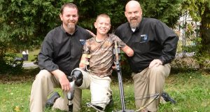 Metro Prosthetics' Dennis G. Haun, left and Peter H. Goller, right, with patient Dayton Webber, center. (Courtesy of Metro Prosthetics Inc.)