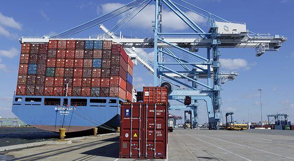 A stack of containers wait pier side to be loaded on a container ship at the Norfolk International Terminal in Norfolk, Va. The Conference Board reports on its index of leading economic indicators for March on Monday, April 21, 2014. (AP Photo/Steve Helber)