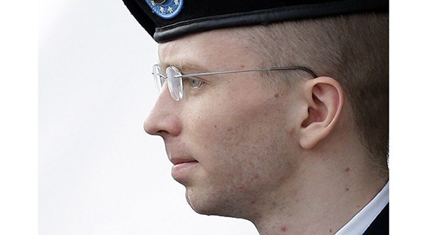 Bradley Manning, who now wishes to be known as Chelsea Manning, is escorted to a security vehicle outside a courthouse in Fort Meade, Md., after a hearing in his court-martial.(AP Photo/Patrick Semansky, File)
