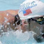 Michael Phelps wins 100 fly heat in comeback meet