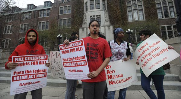 BAMN national organizer Jose Alvarenga and others protest Tuesday's Supreme Court ruling on the campus of the University of Michigan in Ann Arbor. (AP Photo/Detroit News, David Coates )