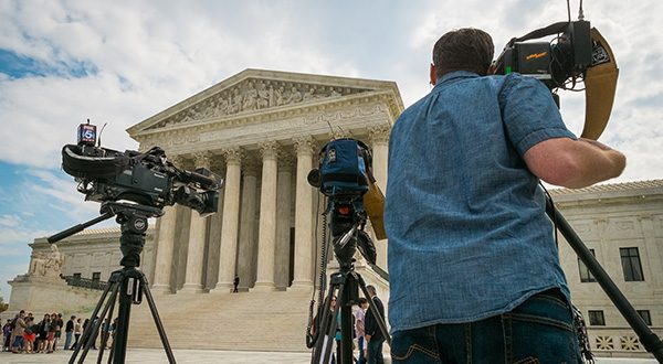 Videojournalists set up outside of the U.S. Supreme Court in Washington, Tuesday, April 22, 2104. The court is hearing arguments between Aereo, Inc., an internet startup company that gives subscribers access to broadcast television on their laptops and other portable devices and the broadcasters. (AP Photo/J. David Ake)
